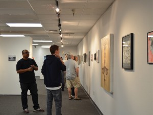 Amanda Johnson -- Students and guests attend opening night of the annual juried Student Art Show.