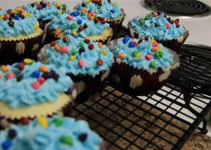 "Photo by Katrina Samuelson ""Brownies and cupcakes come together in this fun recipe for fans of all things sweet. At first glance these delights look like a cupcake, but with one bite you will find a nice layer of brownie to delight."""