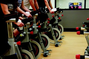 """""""Students take advantage of the CBU recreation center cycling classes that are offered all week.""""Photo by Katrina Samuelson"""