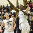 Ivan Patterson, senior business administration major and Lancer guard, scores against Azusa Pacific's Cougars on Feb 7.