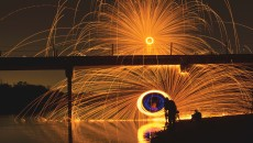 Jacob Gonzalez, freshman photography major, and Micah Paul, CBU alumnus, perform steel wool spinning on a bridge in Sacramento, Calif. Jonathan Logerstedt | Banner