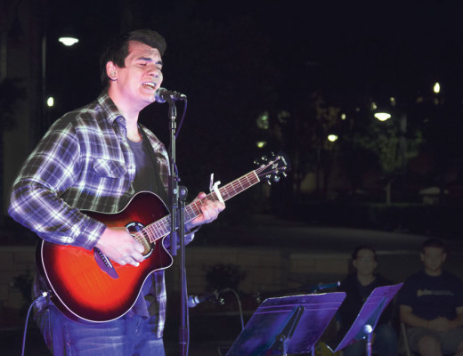 """Zac Marton, junior marketing major, performed """"First Day of My Life"""" by Bright Eyes at Community Life's open mic night Oct. 17. Courtesy of Josh Perez"""