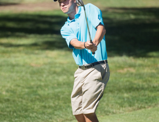 Kavan Eubank, freshman undeclared major, lines up his putt on the first hole during practice at the Victoria Golf Club in Riverside.  The golf teams have competed in three invitationals so far this season. Spencer Findlay | Banner