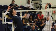 Lauren Hackett, freshman international studies major, jumps to hit the ball during a game against Alaska-Anchorage on Sept. 12. Grace Allen | Banner