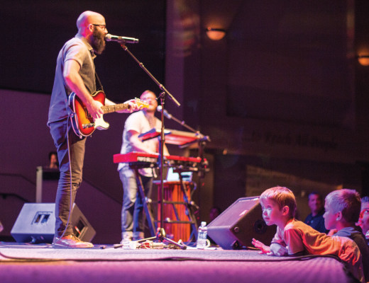 ach Bolen, lead singer of the Seattle worship band Citizens & Saints, plays to a crowd of worshippers at The Grove Community Church. The Grove, which hosts worship outreach events every fourth Sunday, plays songs by the band frequently during their services, which made the event especially significant to their congregation. Tyler Rhode   Banner