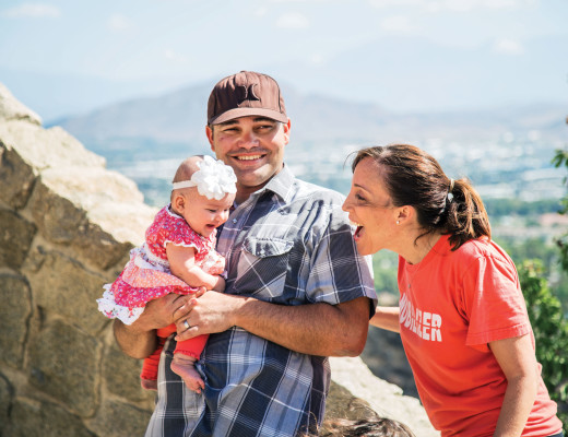 Half way up Mt. Rubidoux, the Welzel family take a break to check out an old castle ruin that still stands. Egged on by Kelli, 4-month-old Kinsley gives a smile and laughs with enjoyment while Keith holds her.