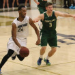 Taj Spencer, junior communication studies major and forward, finds his rhythm in the team's offensive plan as he assists the team in a two-point win over Point Loma Nazarine University on Jan. 17. Courtesy of Lauren Garcia
