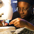 Yvonne Fyne-Nsofor, senior international business major and aspiring fashion designer, sews a summer dress for her next project. Betsy Castellanos | Banner