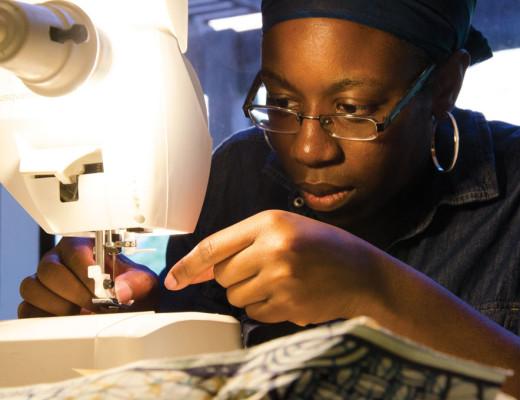 Yvonne Fyne-Nsofor, senior international business major and aspiring fashion designer, sews a summer dress for her next project. Betsy Castellanos | Banner