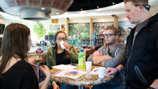 California Baptist University students Chanelle Canfield, Tate Walters and Darren Stevens were part of the group that toured ChocXO Coffee & Cacao in Irvine on Feb. 23.