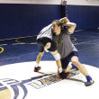 Brendan McFadden | Banner Bryce Benlian, sophomore engineering major, practices with his teammate to prepare for the upcoming wrestling season.