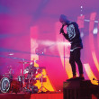 """Tyler Joseph, singer of Twenty One Pilots, performs """"Guns for Hands,"""" from the band's previous album """"Vessel,"""" on top of his piano. Joshua Dun, drummer, plays drums in the background at the Greek Theater in Los Angeles Oct. 15."""
