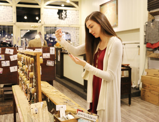 Chloe Tokar   Banner Allison Woldt, Nectar emplyee, inspects one of the store's many necklaces before placing it on the display. Nectar is known for its trendy designs, chic clothing and friendly atmosphere at its original storefront at 12 East State St. in Redlands, California that was founded in 2008 by Tricia and David Kelly