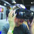 Photo Courtesy of Associated Press A young man tests an earlier prototype of the Oculus headset. The actual Oculus Rift headset is set to release March 28 for $599.