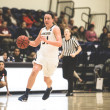 Conner Schuh   Banner Emily Schmidy, sophomore early childhood studies major, guard and forward, dribbles the ball past her defender.