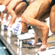 Swimmers take their marks before an individual race at a meet against University of California, San Diego, Jan. 16. The meet was the last homestand of the season before the teams travel to compete in the RMAC championships.