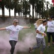 Lauren Shelburne | Banner Participants run through a cloud of pink powder while competing in the Start R.I.G.H.T Challenge 2016 3K Color Run Jan. 23. The Riverside Community Health Foundation has hosted this even since March 2012, this time on the Front Lawn of California Baptist University.