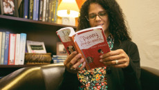 "Crystal Castro | Banner Dr. Veola Vazquez, associate dean of the School for Behavioral Sciences and associate professor of psychology, balances her schedule between being a mother, a professor and an book author. She reads a segment from her most recent book, ""The Penny Predicament,"" which will be published in May and available for purchase on Amazon. This is her second book in a three-book series to be published geared toward younger children."