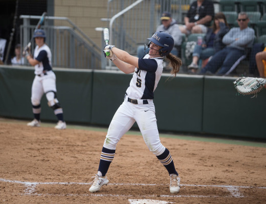 Conner Schuh | Banner Sarah Murphy, sophomore undeclared major and outfielder, uses her powerful swing to earn a run for her team. Murphy has collected several honors.